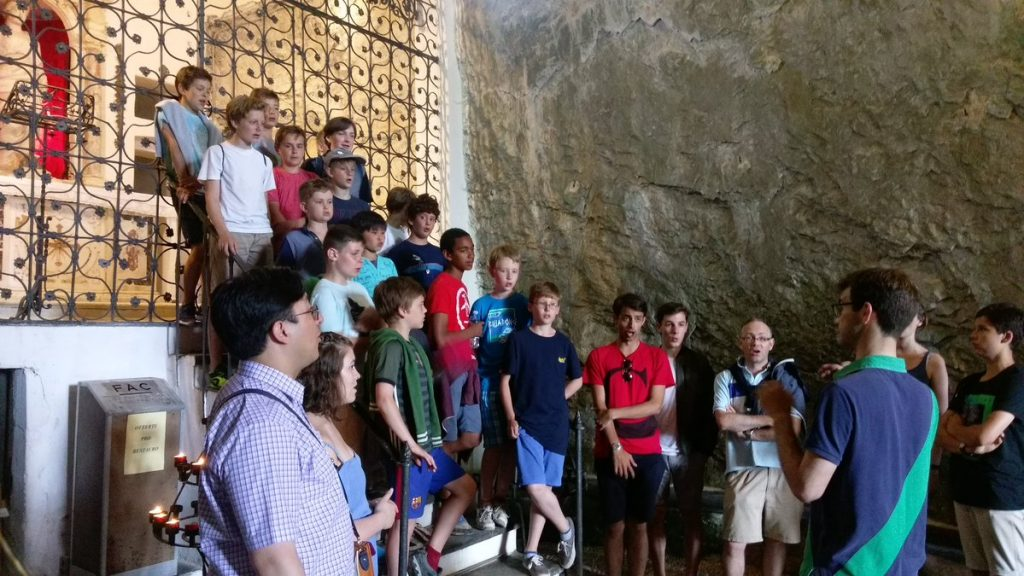 The choir giving an impromptu performance in an underground cave chapel